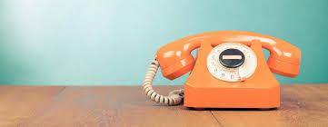 An old school orange dial phone