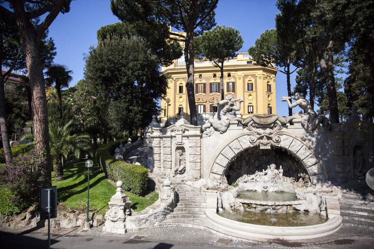 Picture of LUISS University in Rome, Italy with a stone bridge in the foreground